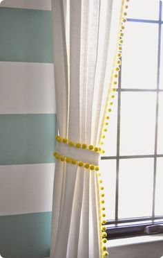 Neon yellow trim with dangling pom-poms adds fun to this all-white curtains. (found on housebeautiful.com)