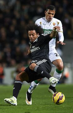 Jonathas (R) of Elche competes for the ball with Marcelo of Real Madrid during the La Liga match between Elche FC and Real Madrid CF at Estadio Manuel Martínez Valero on February 22, 2015 in Elche, Spain.