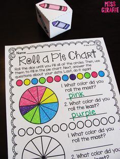 Roll a Pie Chart math center where kids roll the crayon dice and color in the circles then make a pie chart with their data and answer questions about their graph