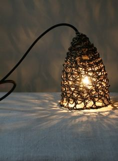 Double threaded woven paper lamp Baladeuse by Best Before  This lampshade woven from a double thread is called Baladeuse and was designed by Best Before. #thecollection