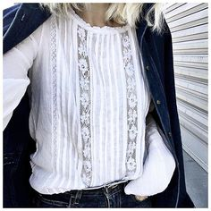 White floral lace blouse with denim jacket and jeans.