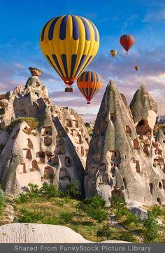 Pictures & images of hot air balloons over Uchisar Castle & cave houses in fair. Air Ballon, Hot Air Balloon, Travel Images, Travel Pictures, Turkey Destinations, Wow Photo, Barbados Travel, Capadocia, Cappadocia Turkey