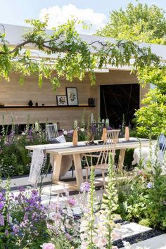 A Scandi-style Garden Room. Designer Hay Joung Hwang. Chelsea Flower Show 2016. Cottage garden.Small space garden ideas with patio, seating area, pergola and flowers