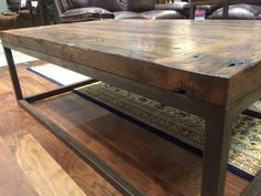 A sleek industrial wooden table. Perfect for your living room | Houston TX | Gallery Furniture |