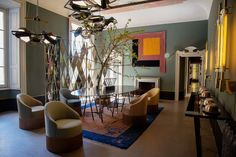 Chinese art deco rug among modernist furnishings // SALONE DEL MOBILE 2014 - DIMOREGALLERY