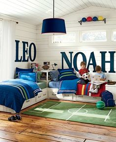 A few adjustments (switch the rug out for a grass rug the color of sand and switch the balls out for sailcloth pillows, shells, oars, sailboats, bouys, or stuffed animal Sea creatures), and you've got yourself the perfect nautical kids room.