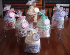 """DIY """"cupcakes"""" made with spa socks and coffee cozy. Perfect spa party favors!"""
