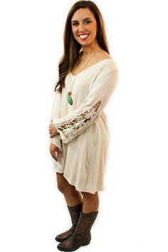 Lace Sleeve Dress - $46.95 - You will look amazing in this lace sleeve dress and you will surely get many compliments with its fashion perfection. The Lace Sleeve Dress is a magnificent cream dress with a high low hemline and full length beautifully crochet lace sleeves.  | available at http://www.envyboutique.us/product/lace-sleeve-dress/ |  #Envy #Boutique #fashion #fashiontrends