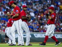 Texas Rangers starting pitcher Yu Darvish (11) jokes with shortstop Elvis Andrus (1) and second baseman Rougned Odor (12) during the fifth inning of their game against the Houston Astros on Wednesday, June 8, 2016 at Globe Life Park in Arlington, Texas. (Ashley Landis/The Dallas Morning News)