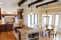 Sink in island facing dining Sink In Island, Commercial Construction, Residential Construction, Kitchen Dining, Dining Rooms, Parade Of Homes, Beautiful Homes, Table, Projects
