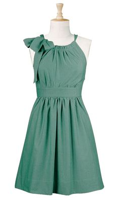 For our maids! The differences: the dress itself was black with a green sash at the neck and one added at the waist with champagne buttons on the side. (I have one in this color and it's one of the most comfortable I own!)