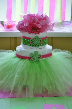 Cute girly diaper cake, love it for a centerpiece but could also be given as a gift with the tutu made to fit the baby girl