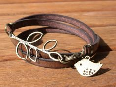 multi wrap dark brown togo flat leather bracelet with brass leaf connector and bird via Etsy.