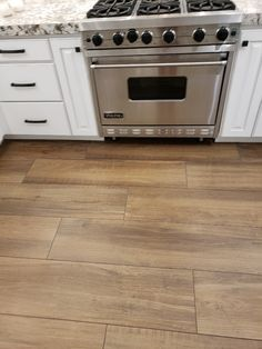 A Las Vegas, NV customer went with Arizona Tile's Aequa Castor x for the of their Kitchen. Look how well it flows with the white Wood Like Tile Flooring, Ceramic Wood Tile Floor, Wood Tile Kitchen, Wood Look Tile Floor, Faux Wood Tiles, Kitchen Flooring, Wood Tiles Design, Kitchen Tiles Design, Las Vegas