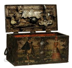 A GERMAN PAINTED IRON TABLE-TOP STRONG BOX  17TH CENTURY  THE KEY HOLE OBSCURED BY A REVOLVING PETAL, THE LOCK WITH FOUR BOLTS AND ENGRAVED DECORATION, THE FRONT PANEL WITH A PAIR OF COURTING FIGURES, THE OTHER PANELS PAINTED WITH FLOWERS 9¼ IN. (23.5 CM.) WIDE