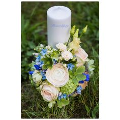Baby Blue  #babyboy #baptism #flowers #candle #blue #green #special #flowerdipity#event Pillar Candles, Baby Blue, Flowers, Blue Green, Candles, Royal Icing Flowers, Flower, Taper Candles, Florals