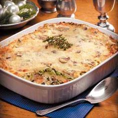 Seafood Lasagna Alfredo Recipe -Once when expecting a visit from a college friend, I wanted to serve something a little different. So I came up with this lasagna. It's perfect for company because it can be assembled in advance. —Dolores Jensen, Arnold, Missouri