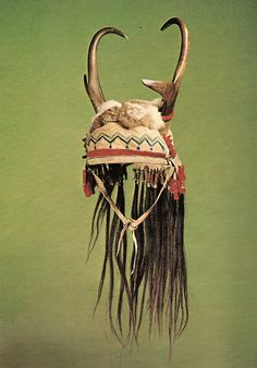 Antelope headdress decorated with paint, fur, hair and trade cloth. About 1900. Length 25 in. (63.5 cm). Chiricahua Apache, ...