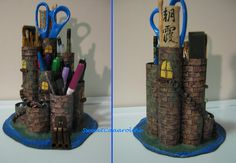 A castle themed desk organizer I made from paper towel tubes, paint and beads. Moat included.