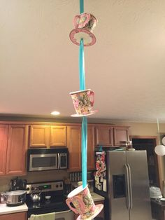 Alice in Wonderland party. Ordered 'Truly Alice' tea cups/platters, ran ribbon through them for ceiling decor