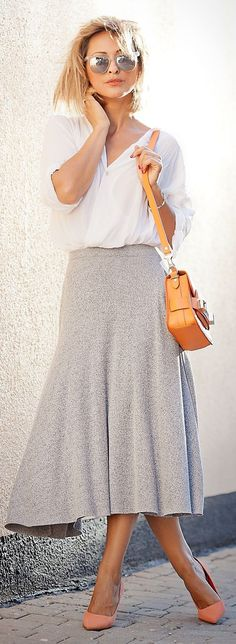 This flared midi skirt is everything. Paired with pale pink pumps? Absolutely yes.