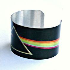 Aluminum Cuff Bracelet with The Dark Side of the Moon by Pink Floyd,... ($20) ❤ liked on Polyvore featuring jewelry, bracelets, dark jewelry, cuff bracelet, cuff bangle bracelet, hinged cuff bracelet and cuff bangle