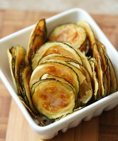 Tasty Zucchini Chips  Prep Time: 10 minutes Yield: 50+ zucchini chips Cook Time: 2 hours  You will need:  	1 large zucchini 	2 tbsp. olive oil 	Ko