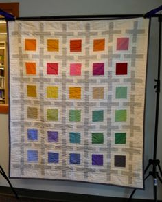 An awesome modern quilt, entirely in Kona solids (a dusty charm pack, and Kona Snow, Ash and Coal solids). I want to recreate this so badly.