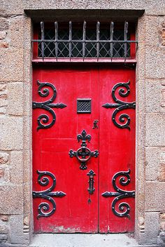 Red medieval door in Mont Saint Michel Abbey in France. By the Artist ~ Elena Elisseeva on redbubble.com