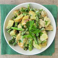 This potato salad is hard not to love with roasted potatoes, roasted asparagus and a light and tangy Dijon yogurt dressing.