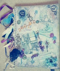 A3 scrapbook, mixed media cover with reclaimed Alice in wonderland book pages, ribbons, lace, wooden swirls, scrabble squares, buttons, twine, tissue, metal charms, paper flowers, glass bead gel, gesso, distressed ink and marker pen