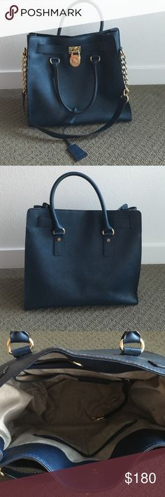Michael Kors Saffiano Leather Navy Purse This navy purse was barely used. I just have too much to carry to work. Looks brand new. Inside has normal usage markings but no physical damage. Michael Kors Bags Totes