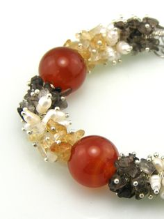 Gemstone Cluster Beaded Bracelet  Etsy, $35.00  Beautiful clusters of freshwater pearls and smoky quartz, amber beads.. large agate accent beads are in between the clusters.  www.trinketsnwhatnots.etsy.com