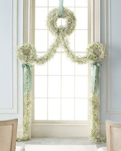 Wedding Ceremony Garland: Bundle airy baby's breath into a wreath-dotted swag and delicate table spray. The secret ingredients behind this jaw-dropping, simple-to-make backdrop are foam wreath forms and basic rope. —Martha Stewart Weddings