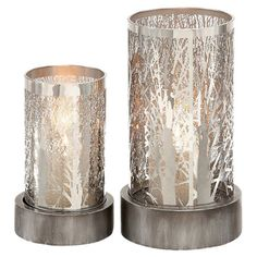 2-piece votive holder set with tree branch-inspired cut-outs.    Product: Small and large votive holderConstruction ...
