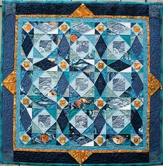 My favorite quilt pattern…gonna make it some day! A beautiful storm at sea with whales and shells, and even a lighthouse quilted into one of the diamonds. Oceana, by Linda Jean Peterson