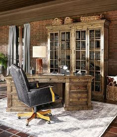 "The Corbel desk surrounded by other ""working"" pieces. Exclusively available at Arhaus."