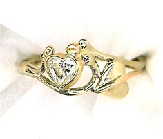 Custom, one of a kind engagement ring designed by Stephanie Long with heart-cut diamond and 14k gold.  Have your ring designed at Goldcrafter's Corner. http://goldcrafterscorner.com/