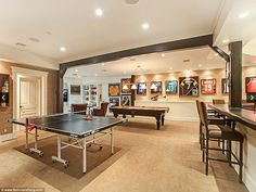 Naturally for a sportsman, Norman has a large games room, complete with table-tennis and snooker tables, plus framed shirts of NFL stars Game Room Tables, Game Room Bar, Garage Game Rooms, Game Room Basement, Florida Mansion, Man Cave Home Bar, Game Room Design, Room Interior Design, Basement Remodeling