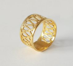 unique gold ring in 14k yellow gold, gentle texture and wire pattern
