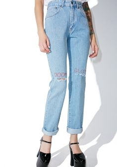 The Ragged Priest Outlook Jeans ...basically yer everyday approach to life. These dope mom jeans feature a classikk light blue denim construction, high waisted cut, slouchy straight fit down tha leg, ripped knees with thin red embroidery above that reads 'Doom' and 'Gloom,' and zipper fly 'N button closure.