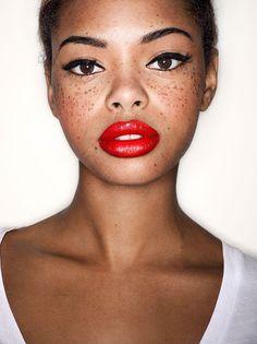 Red lips and freckles.