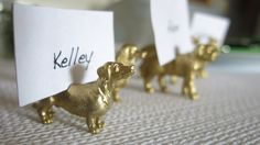 Spray painted plastic animals for place card holders - fun idea!