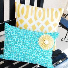 The easiest and most inexpensive way to make pillows..use placemats! Also includes a tutorial on how to make fabric rosettes.