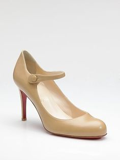 Christian Louboutin Mary Jane.  Classic shoe when worn with a pant, and extra cute when worn with a skirt.