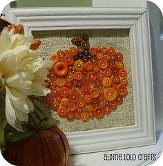 Button crafts! - a fall button pumpkin... cute.  But what about a 4 season set of button trees, winter, spring, summer, fall, flag, Christmas tree/wreath, Easter symbol, what ever tickles your buttons fetish.  These are all the same size & designed to be used in a decorative frame interchangeably.
