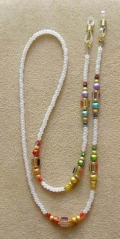 THIS CHAIN IS DONE WITH FURNACE GLASS RAINBOW BEADS WITH MATHCING SWAROVSKI CRYSTALS AND ENAMELED GLASS BEADS, IT IS FINISHED WITH WHITE PEARL CZECH GLASS