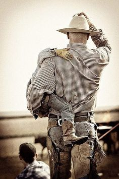 A man in wranglers, boots, a flannel, and a hat is all you need!