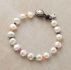 pearl rainbow bracelet.. this is cute I have the pearls and all the stuff I could make this..