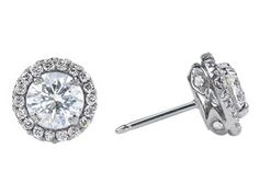 These Forevermark® stud earrings feature a round halo with a prong set round cut Forevermark® diamond center stone that is surrounded by micropave diamonds and accented by micropave diamonds on the mounting.